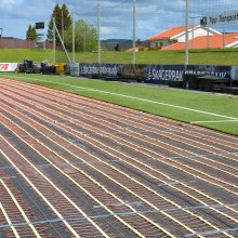 Heating of playing surfaces with artificial grass.